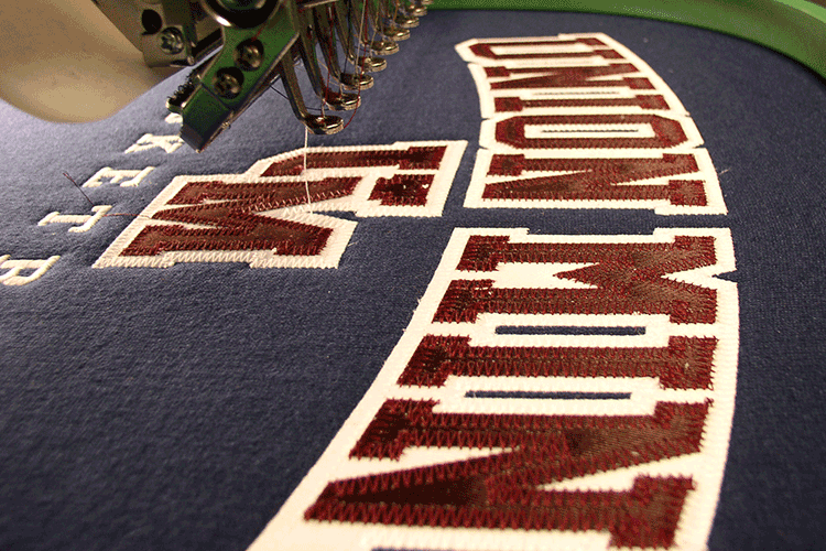 Union Mine hoodie being sewn